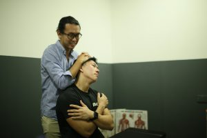 lawyer singapore, joshua woo, neck pain test